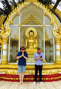 Alex and his cousin showing respect to the Buddha.